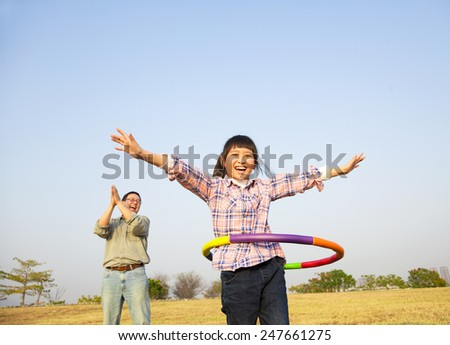 happy kid playing  hula hoops outdoors - stock photo