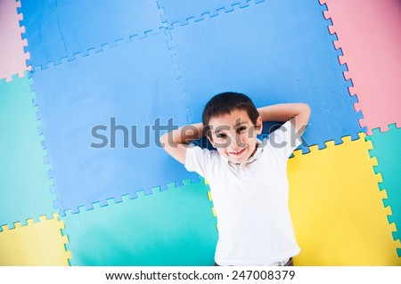 Happy kid playing in playground - stock photo