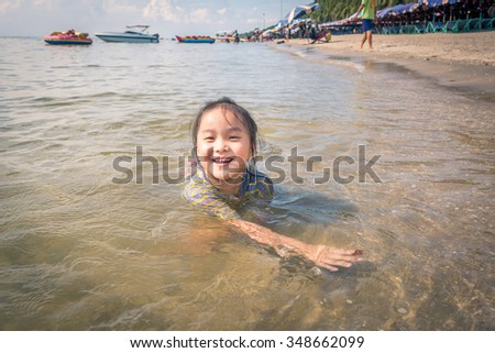 happy kid playing on beach at the day time