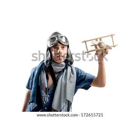 Happy kid playing with toy airplane on white background - stock photo