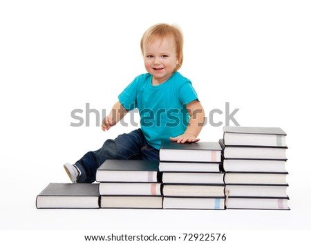 Happy kid sitting on the steps of books isolated on white - stock photo