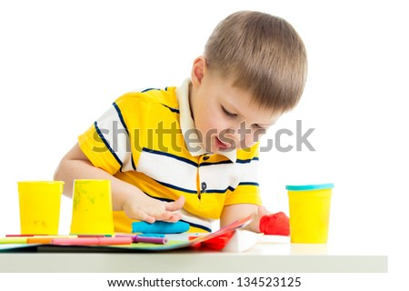 Happy kid with colorful clay toy