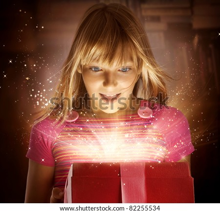 Happy Kid with Gift - stock photo