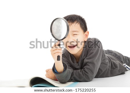 happy kid with magnifying glass and book - stock photo