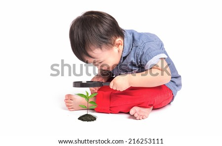 happy kid with magnifying glass, exploring the environment isolated on white background - stock photo
