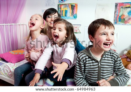 Happy kids and their mother - stock photo