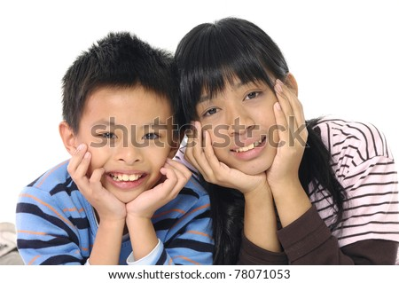 happy kids boy and girl lie on floor - stock photo
