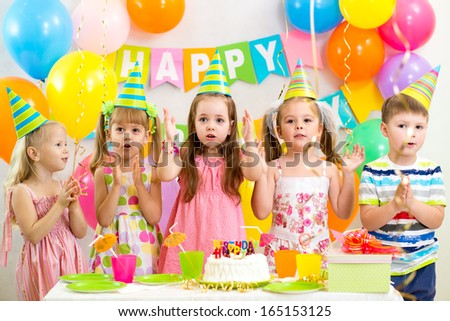 happy kids celebrating birthday holiday - stock photo