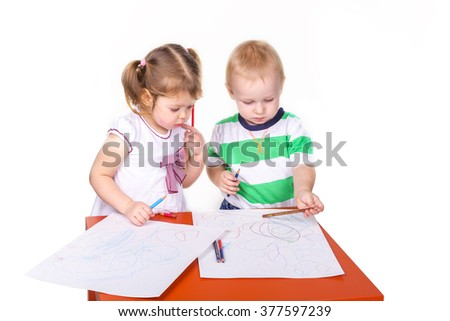 Happy kids drawing isolated on white. Team work, creativity concept.