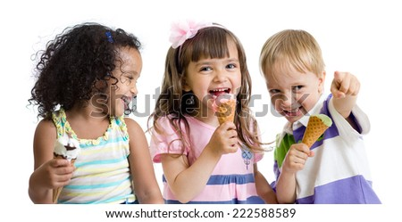happy kids eating ice cream in studio isolated on white - stock photo