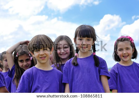 happy kids group have fun in nature outdoors park - stock photo