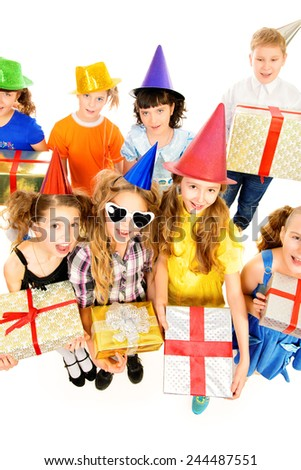 Happy kids having fun at a party. Holidays. Gifts. Isolated over white. - stock photo