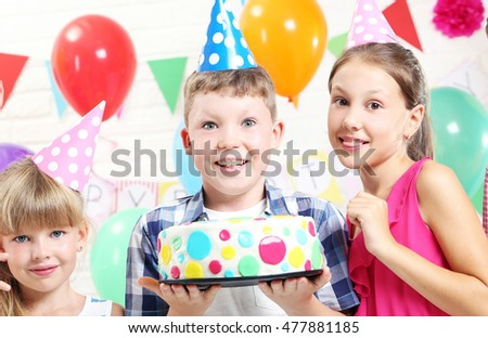 Happy kids having fun at birthday party
