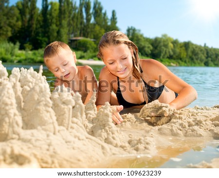 Happy kids Having Fun at the Beach in summer . River