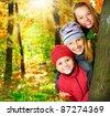Happy Kids Having Fun in Autumn Park.Outdoors - stock photo