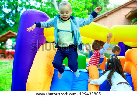 happy kids having fun on playground - stock photo
