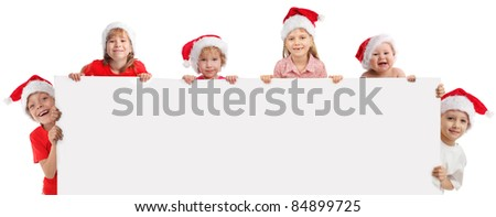 Happy kids  in christmas caps, holding the banner in his hand