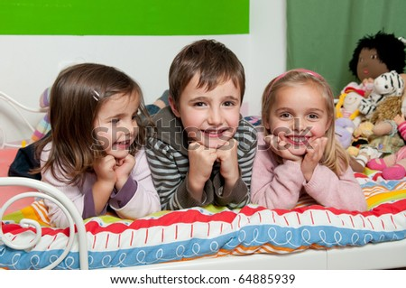 Happy kids in their room - stock photo