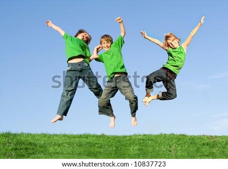 happy kids jumping for joy - stock photo