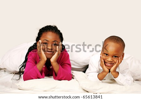 Happy kids listening to bedtime story - stock photo