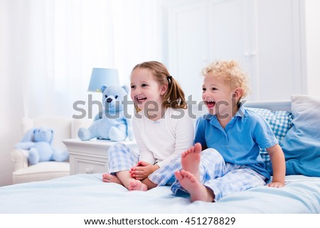 Happy kids playing in white bedroom  Little boy and girl  brother and  sister play. Nightwear Stock Images  Royalty Free Images   Vectors   Shutterstock