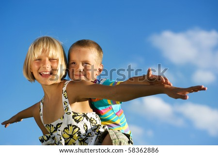 Happy Kids.Sister and Brother outdoor - stock photo