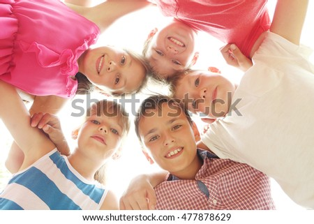 Happy kids standing in circle