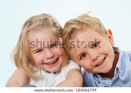 Happy kids, studio shot isolated on sky blue background