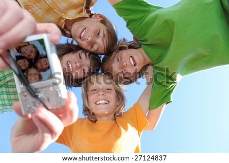 happy kids taking photo - stock photo