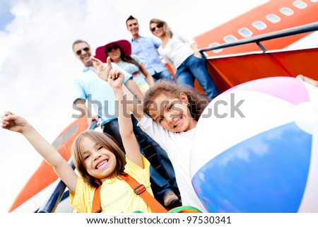 Happy kids traveling by airplane for their vacations - stock photo