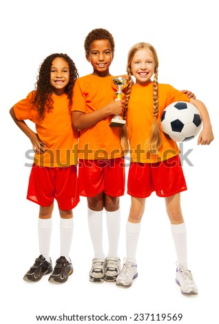 Happy kids winners of soccer games - stock photo