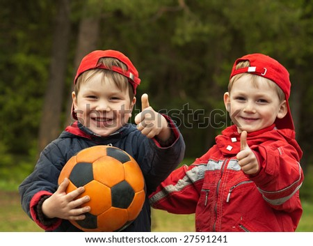 Happy kids with a ball - stock photo