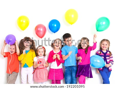 Happy kids with balls - stock photo