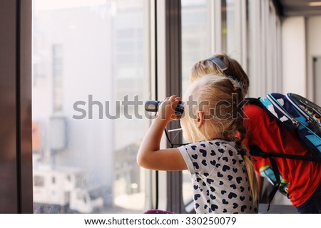 Happy kids with binoculars - stock photo
