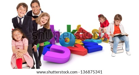 Happy kids with different ages around a multicolored alphabet - stock photo