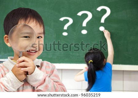 happy kids with drawing question mark in the classroom - stock photo