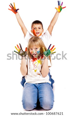 Happy kids with hands painted in colorful paints over white background - stock photo