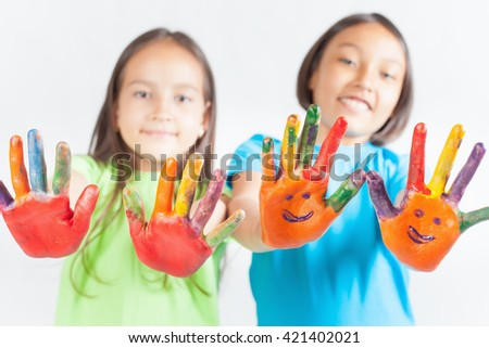 Happy kids with painted hands on a white background. International Children's Day. Painting, occupation - stock photo