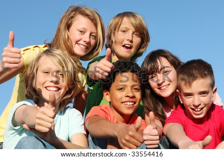 happy kids with thumbs up - stock photo