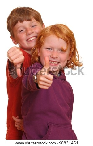 Happy kids with thumbs-up - stock photo