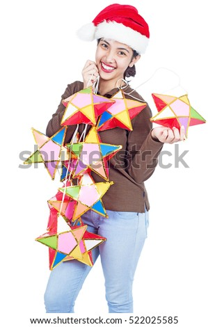Happy lady holding a bunch of star-shaped lantern for christmas decoration. Isolated in white background.