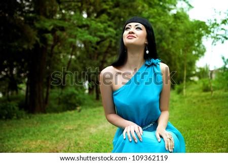 Happy lady in dress in summer garden smilling - stock photo