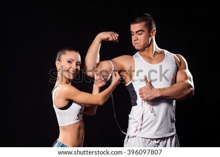 happy lady measuring bodybuilders arm fitness stock photo 396097807 shutterstock. Black Bedroom Furniture Sets. Home Design Ideas