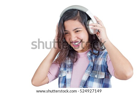 Happy lady with headphone listening and enjoying the music. Isolated in white background.