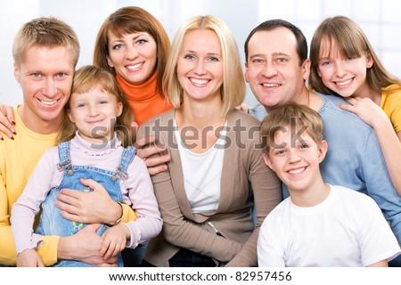 Happy large family  looking at camera - stock photo