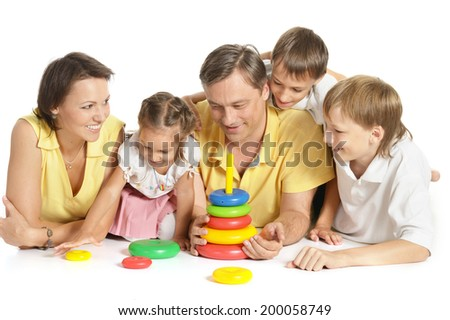 happy large family playing on floor at home - stock photo