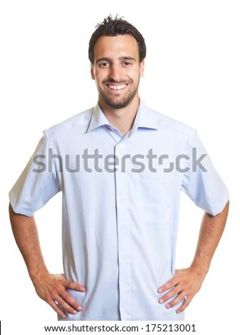 Happy latin man in a blue shirt - stock photo