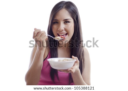 Happy latin woman having a healthy breakfast