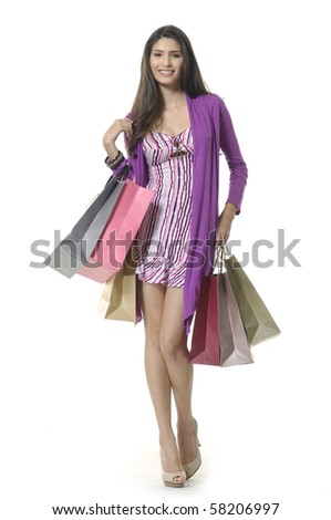 happy laughing adult girl with shopping bags - stock photo