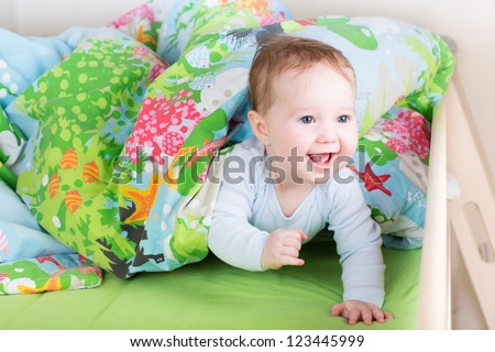 Happy laughing baby playing peek-a-boo - stock photo